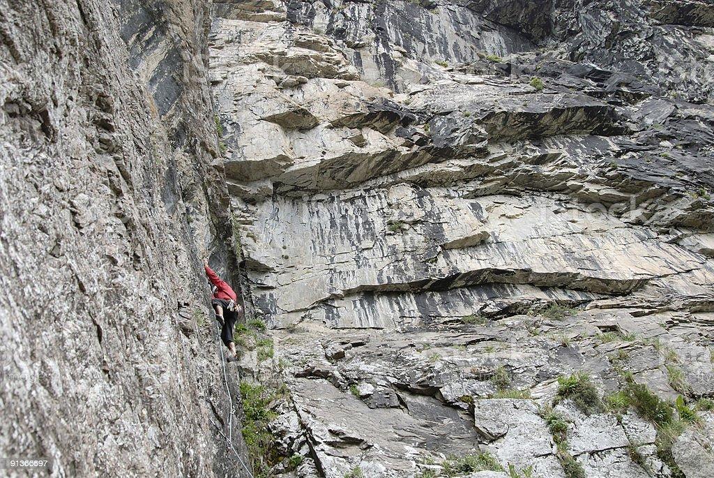 climber climbing a cliff royalty-free stock photo