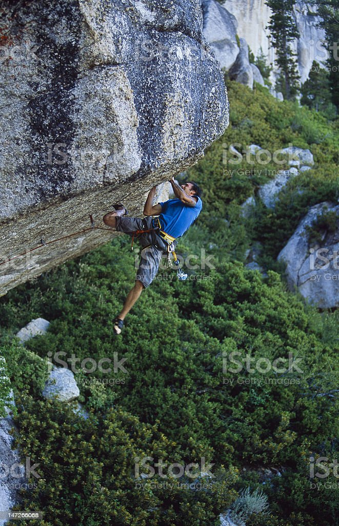 Climber clinging to a cliff. royalty-free stock photo