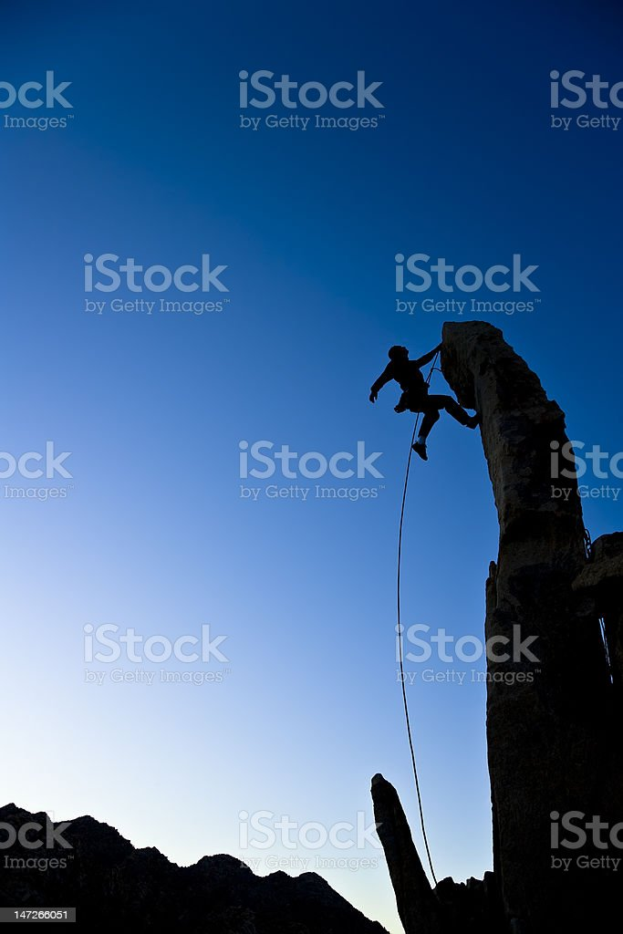 Climber dangling from a pinnacle. royalty-free stock photo