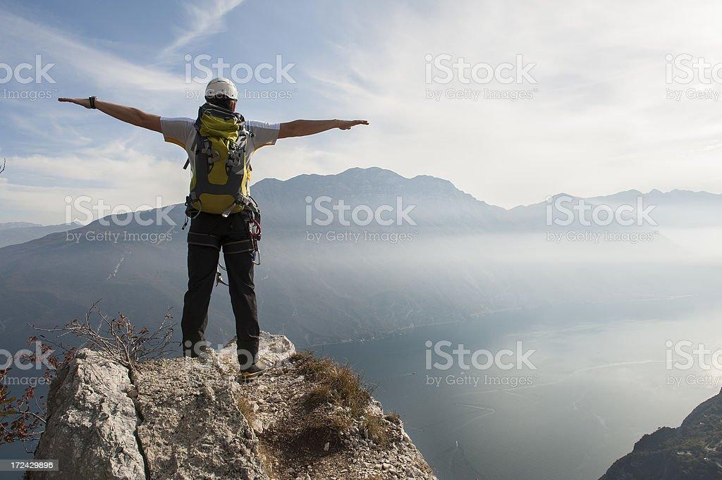 Climber feels free to the Garda Lake stock photo