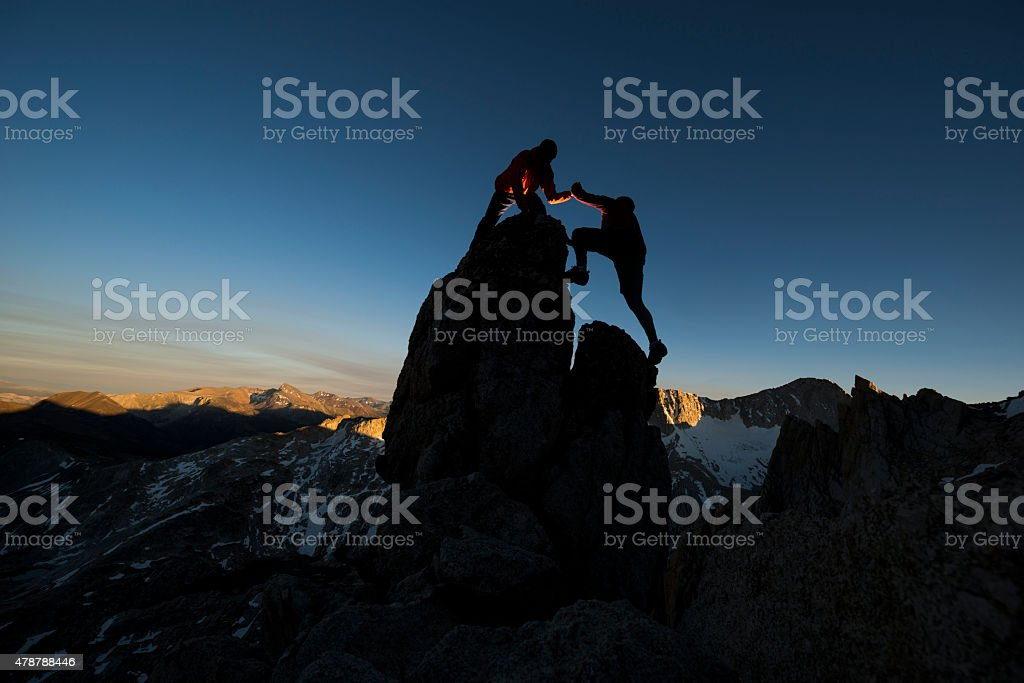 climber helping stock photo