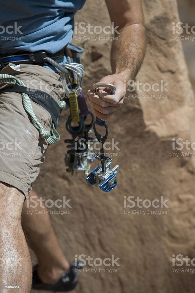 Climber holding camming device stock photo