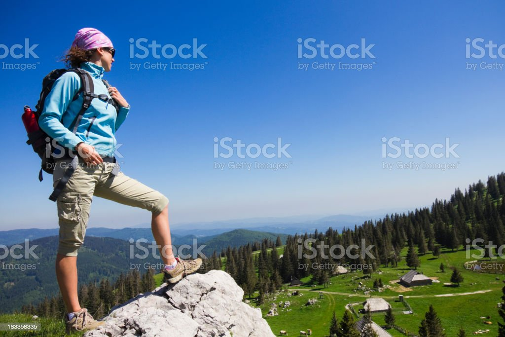 A climber looking at the top of a mountain stock photo