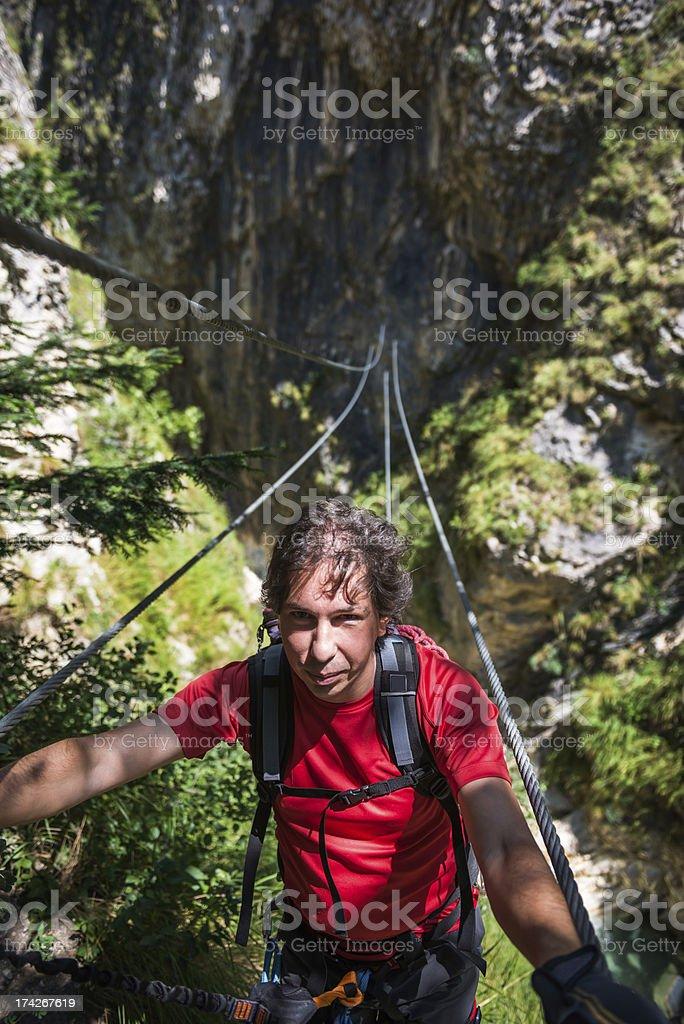 Climber on a Rope Bridge royalty-free stock photo