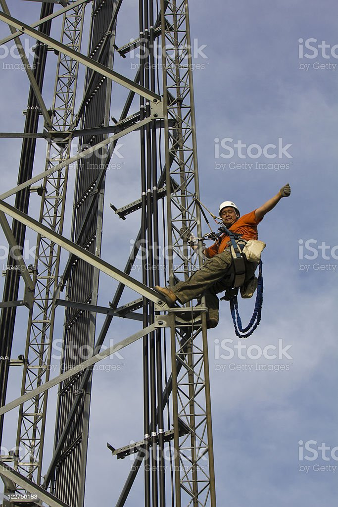 Climber on cell tower stock photo
