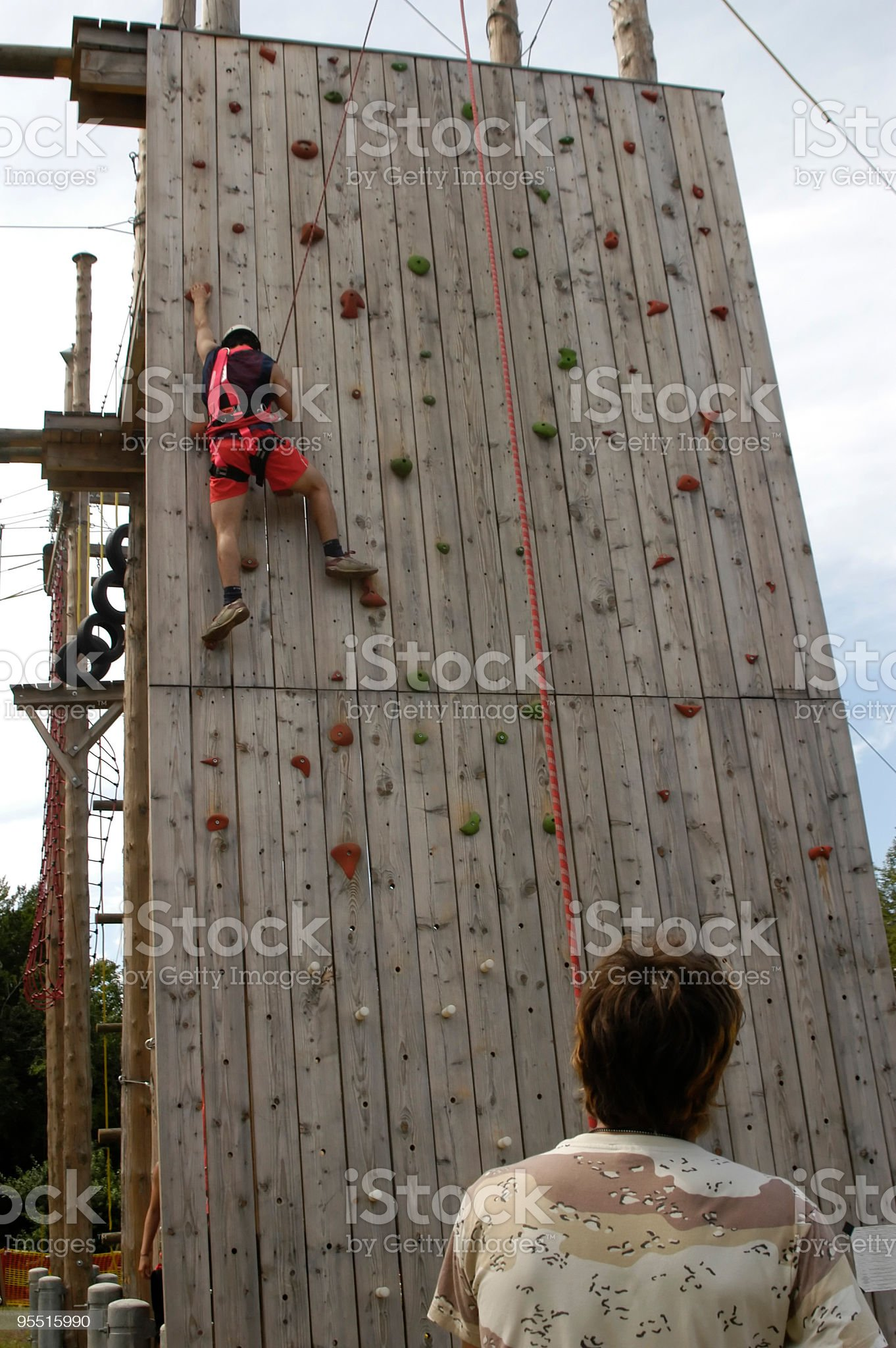 Climber on climbing wall in Amusement Park royalty-free stock photo