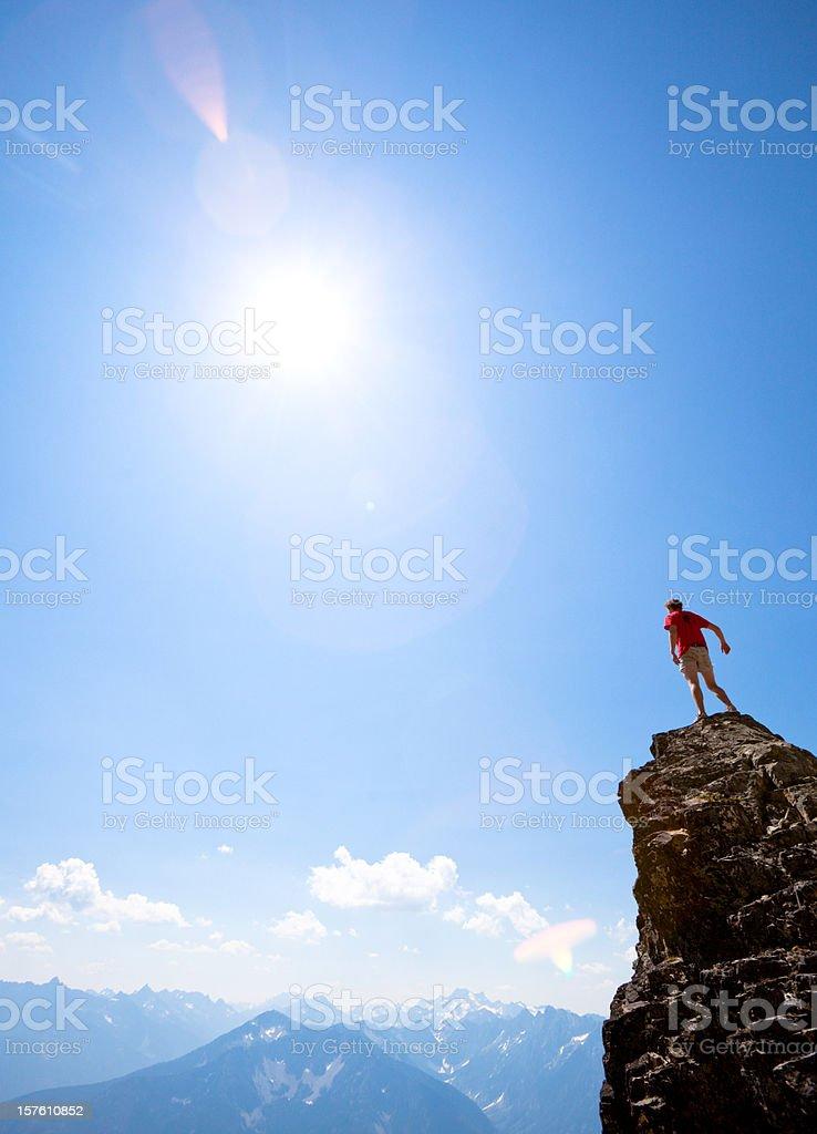 Climber on mountain peak stock photo