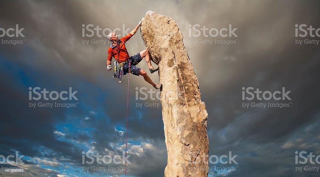 Climber on the edge. stock photo