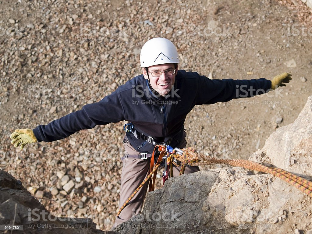 climber on the rock with arms wide open royalty-free stock photo