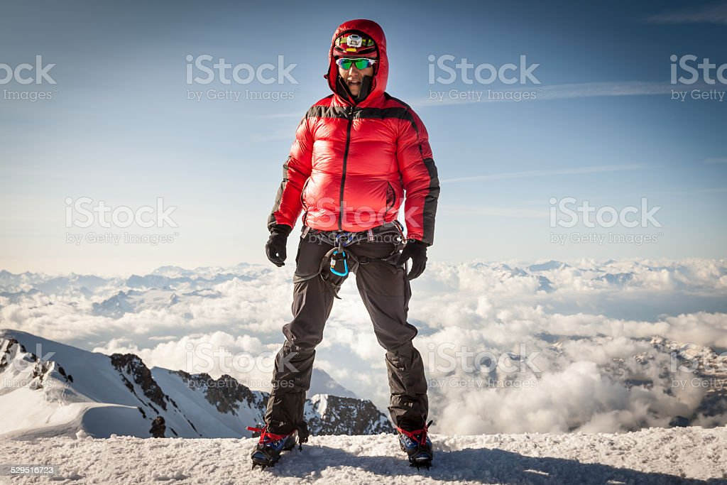 Climber on the summit of Mont Blanc stock photo