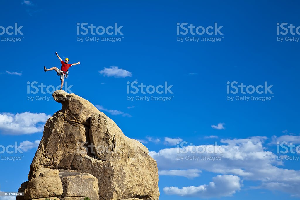 Climber on the summit. royalty-free stock photo