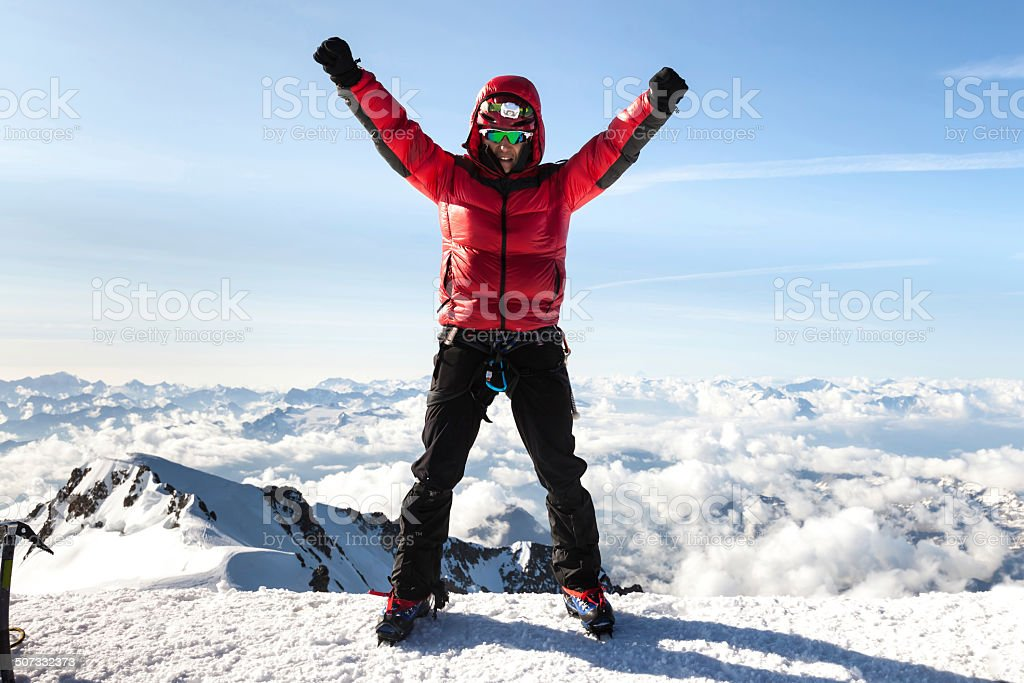 Climber on the top of Mont Blanc stock photo