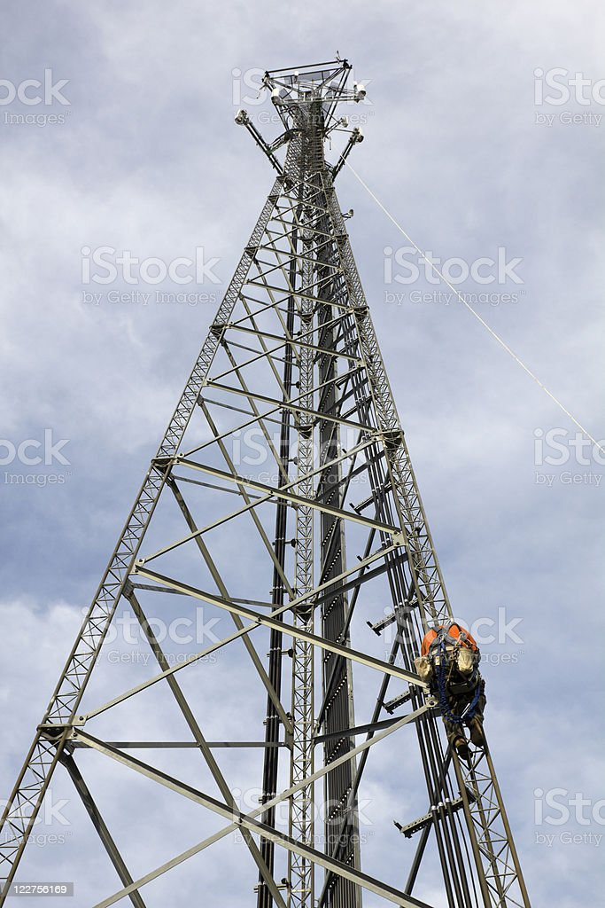 Climber on the tower stock photo