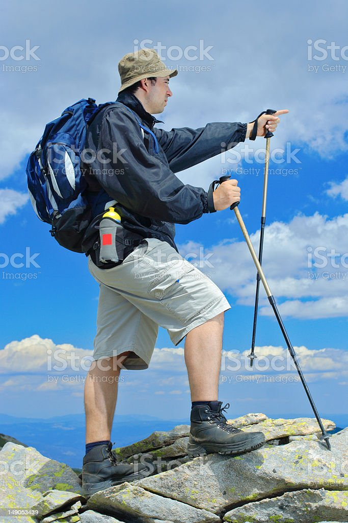 Climber on top of a mountain royalty-free stock photo