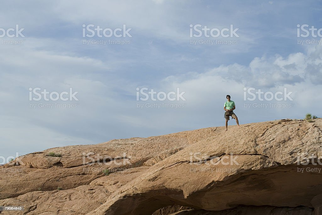 Climber on top of a rock royalty-free stock photo
