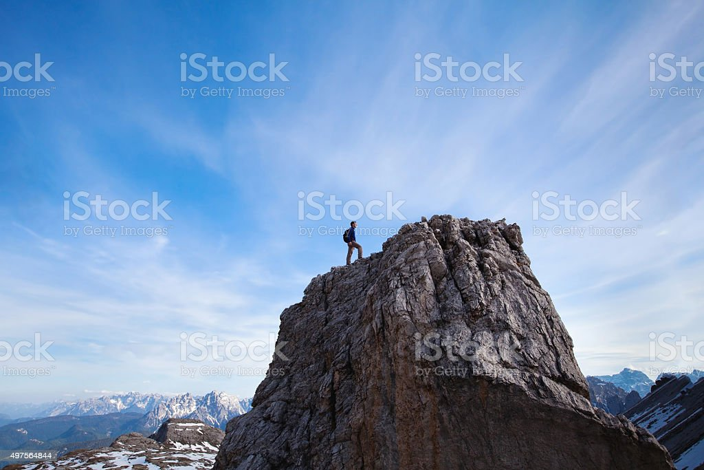 climber on top of the mountain stock photo