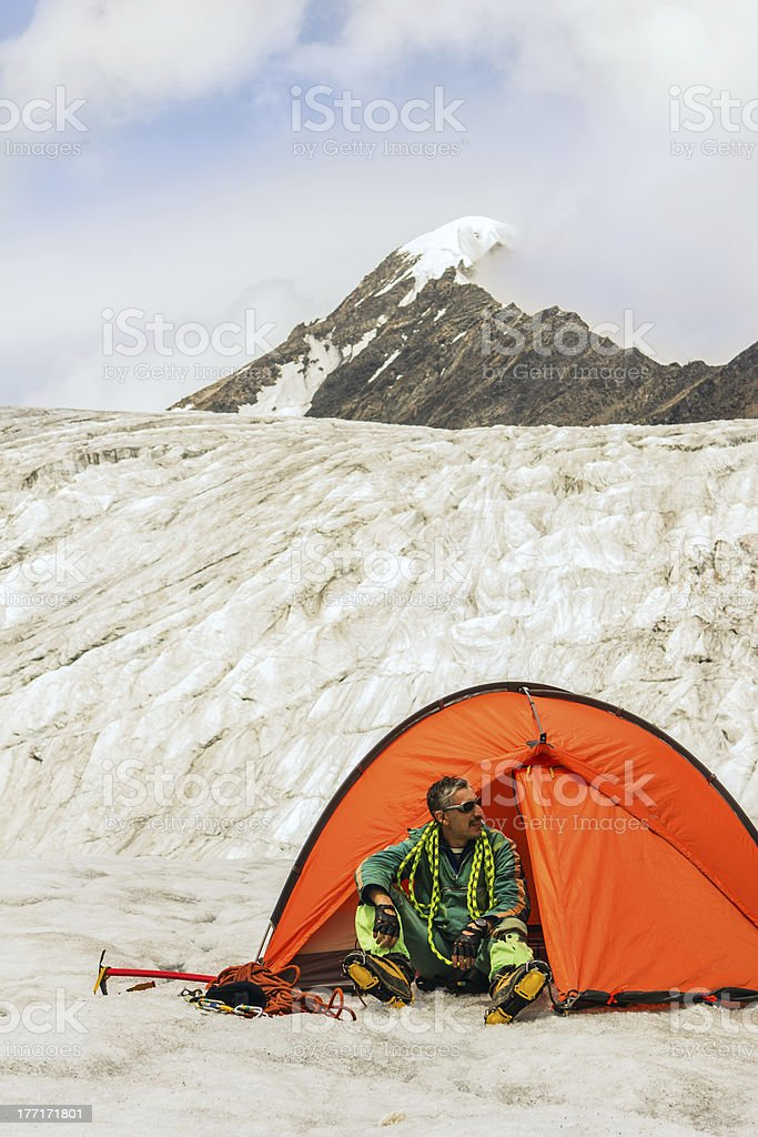 Climber prepares equipment for ascension on top royalty-free stock photo