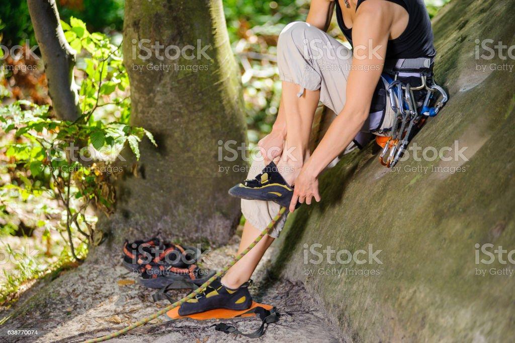 Climber putting climbing shoes on - close up stock photo