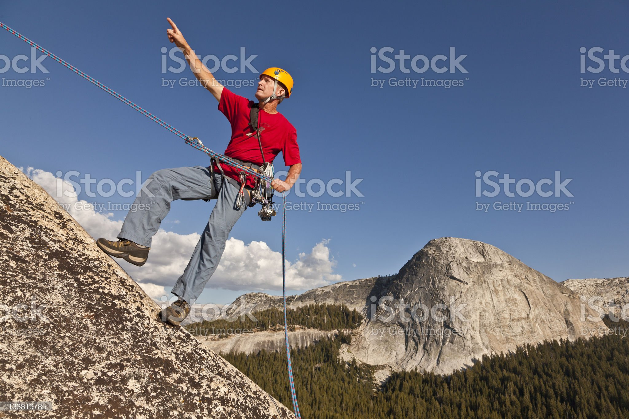 Climber rappelling from the summit. royalty-free stock photo