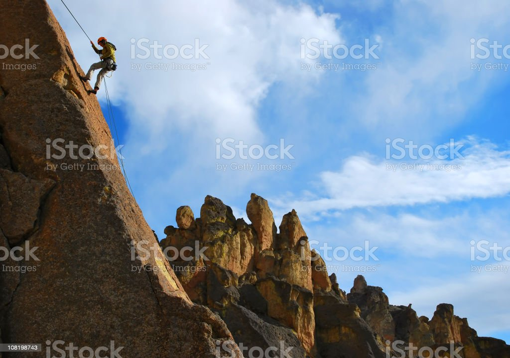 Climber rappelling stock photo