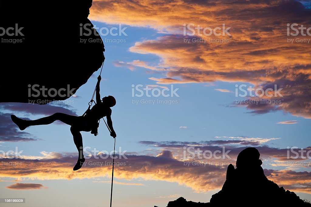 Climber rappelling. stock photo
