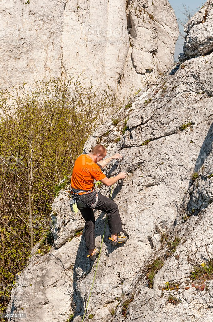 Climber Rrepares Rappel Stance stock photo