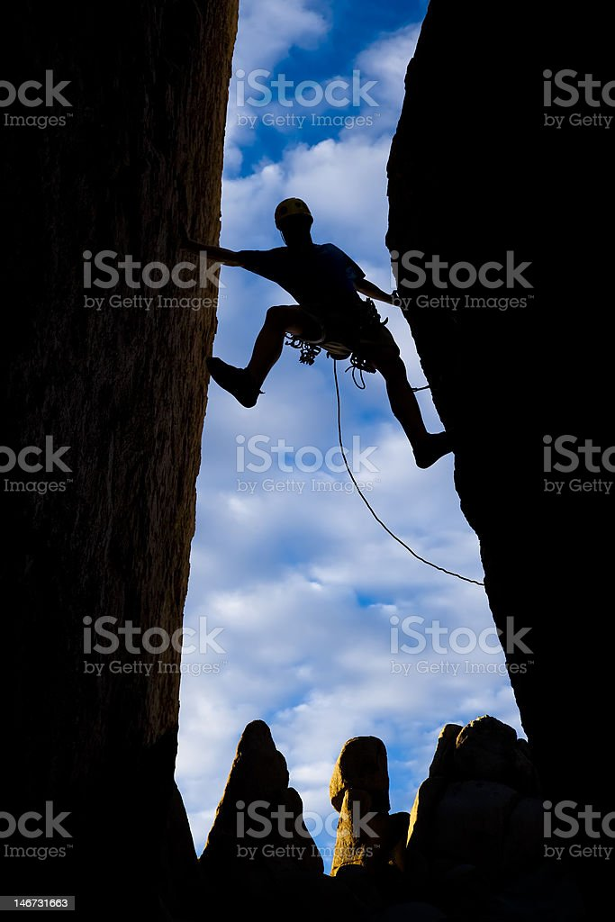 Climber stretches across a gap. royalty-free stock photo