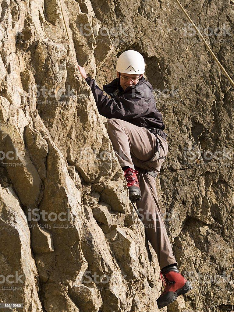 climber swarming up royalty-free stock photo