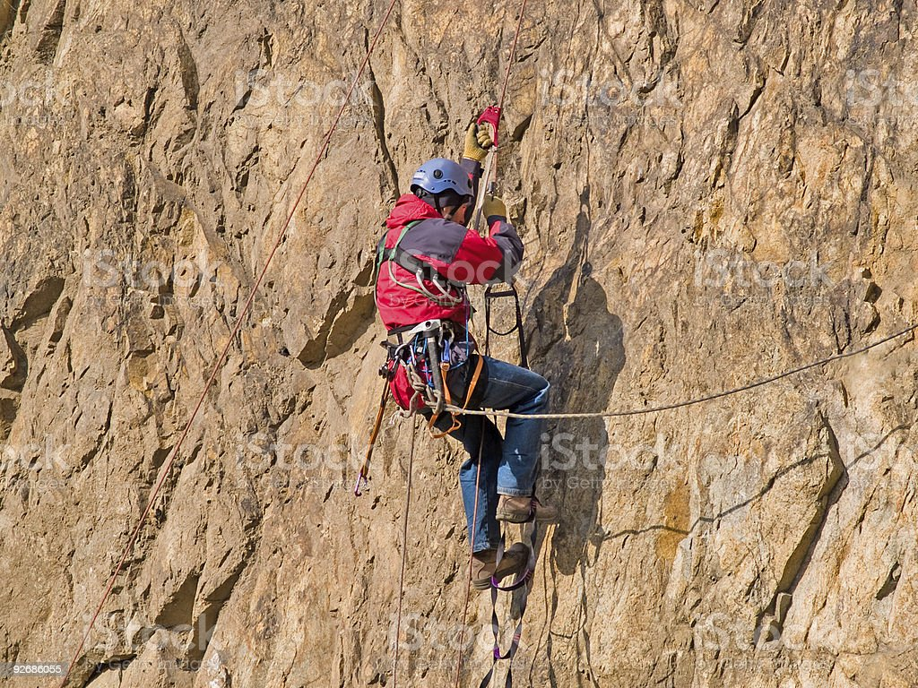 climber swarming up the rock royalty-free stock photo