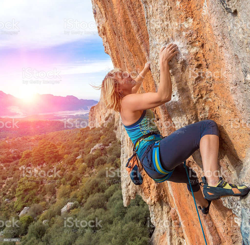 Climber Trying keep Hold in last Effort avoid deep fall stock photo