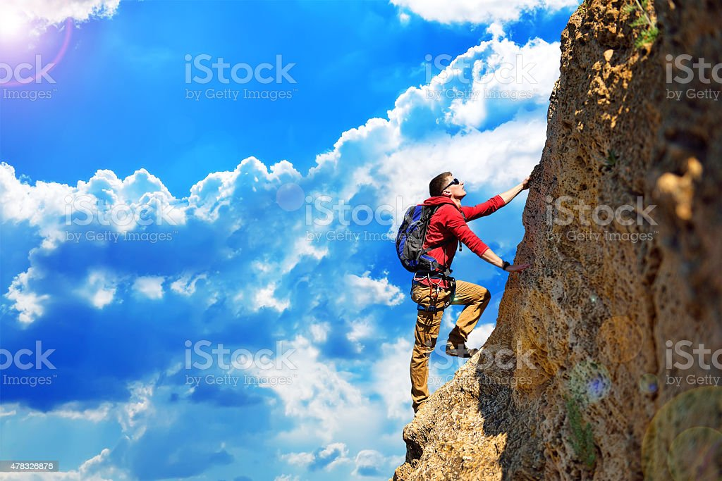 climber with backpack stock photo