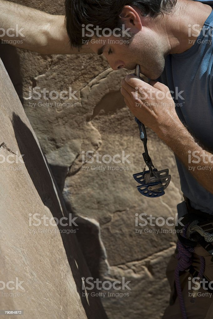 Climber with camming device stock photo