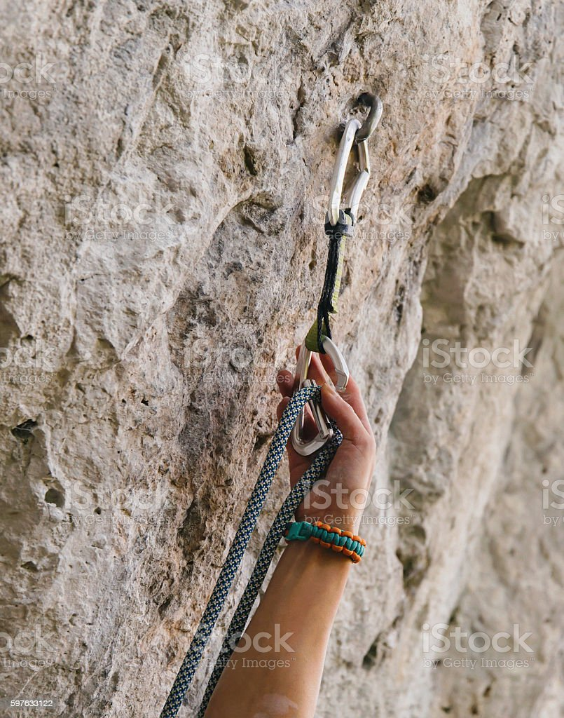 Climber with rope and quick-draw stock photo