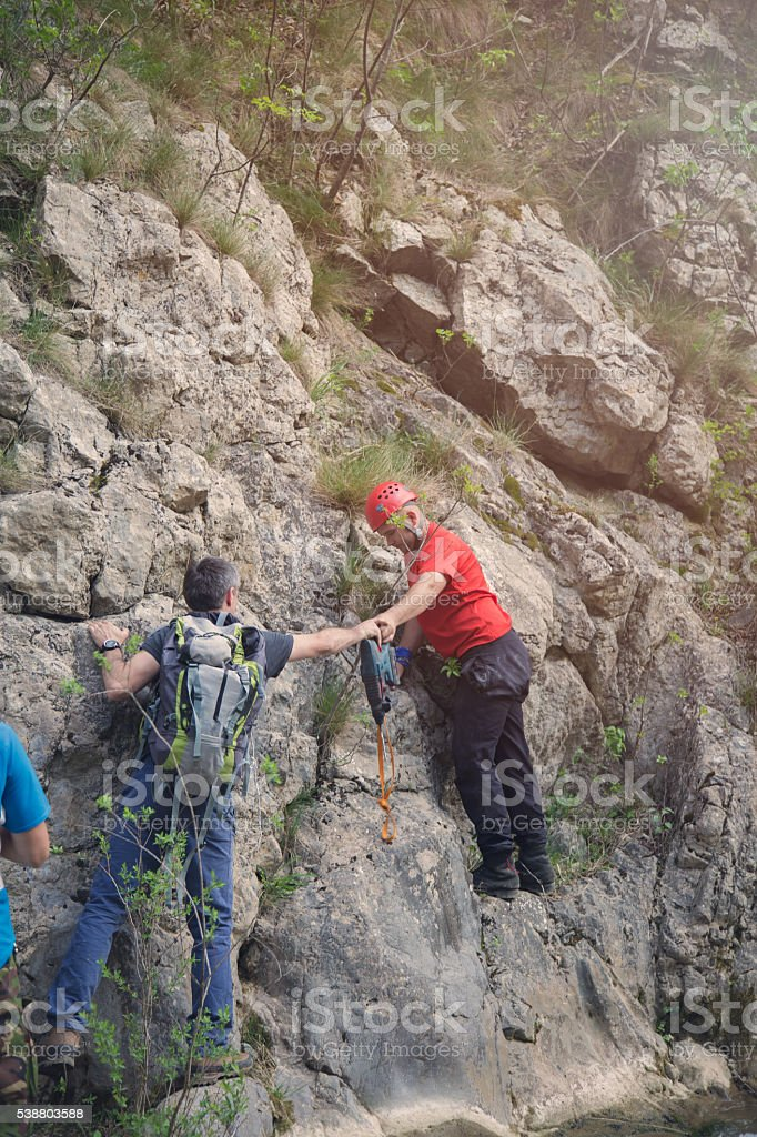 climbers are drilled and set up a bolt stock photo