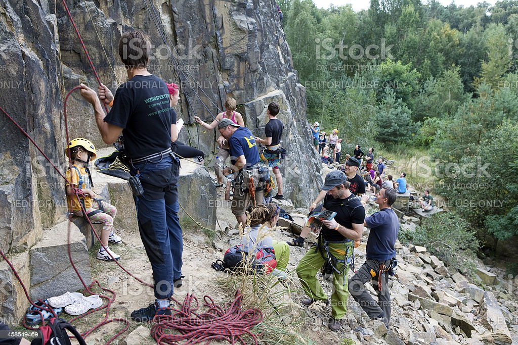 climbers at the bottom of a rock face stock photo