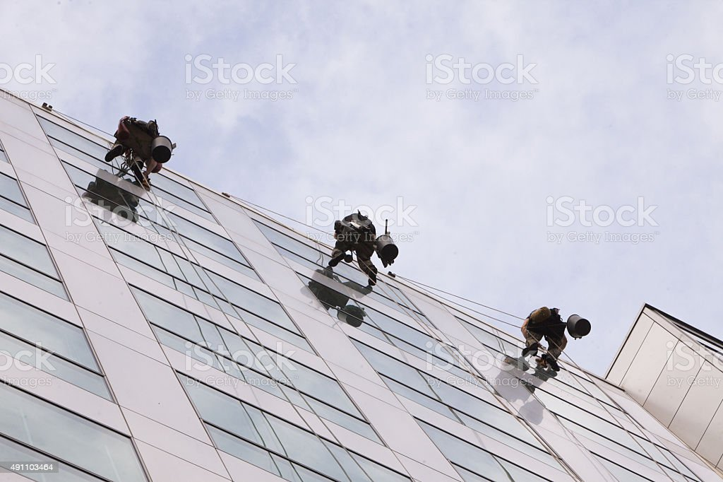Climbers clean the windows stock photo