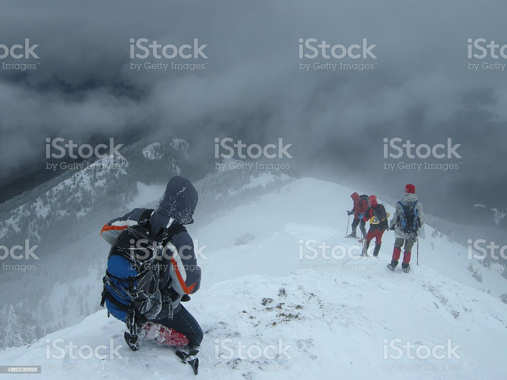 Climbers Entering The Snow Abyss stock photo