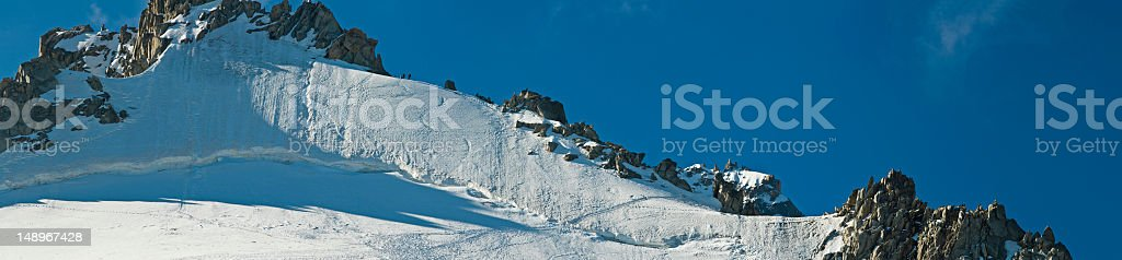 Climbers high on Alpine ridge royalty-free stock photo