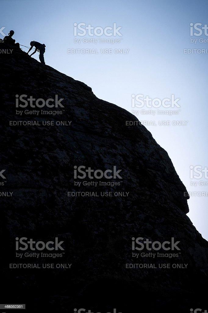 Climbers on Haytor Rocks, Dartmoor National Park stock photo