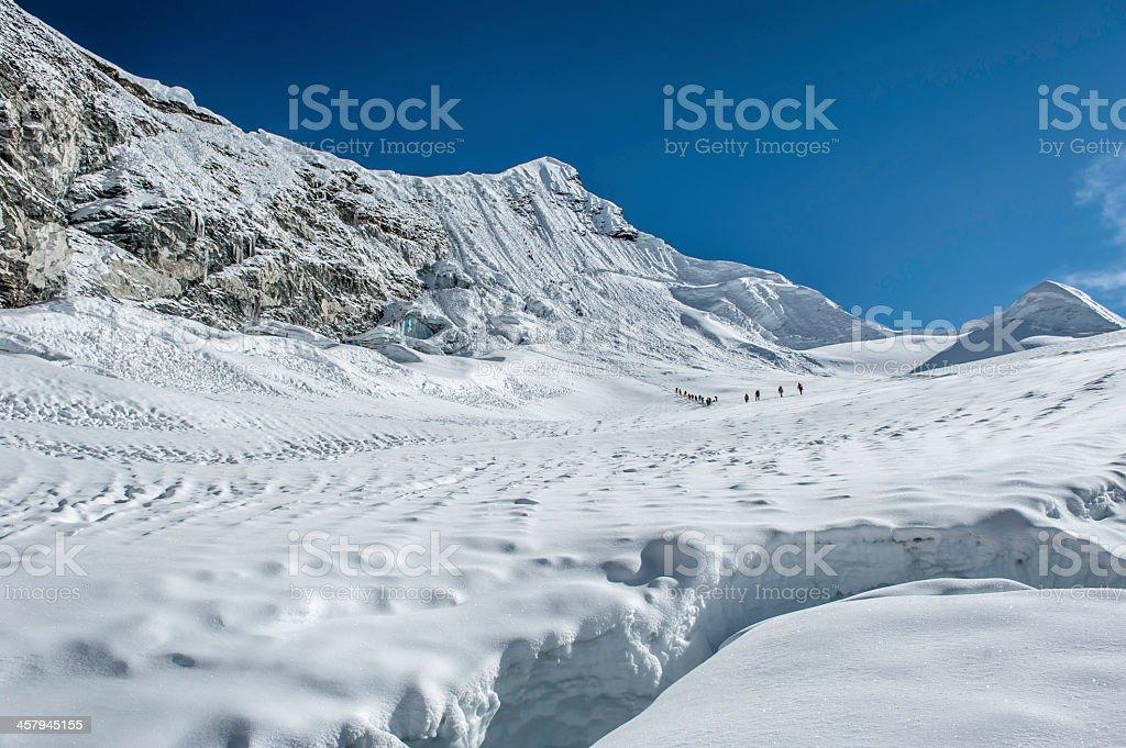 Climbers on high mountain trail Himalayas Nepal stock photo