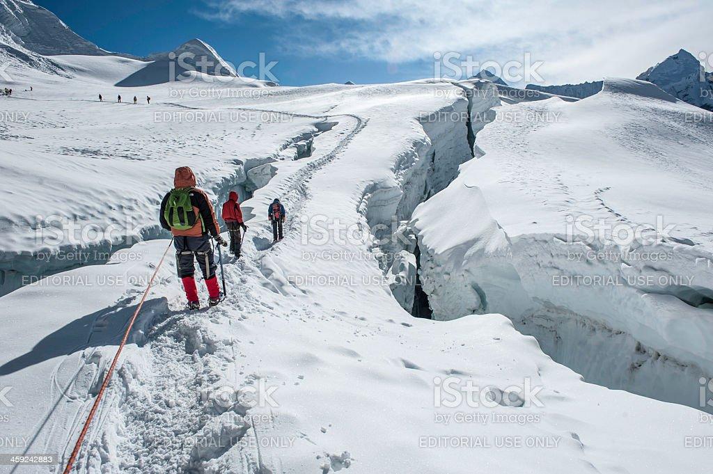 Climbers on high mountain trail Himalayas Nepal royalty-free stock photo