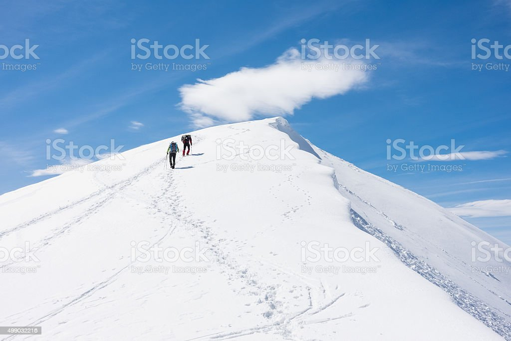 Climbers on the mountain top stock photo