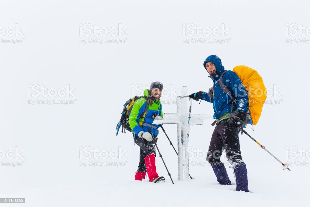 Climbers on the summit of the mountain stock photo