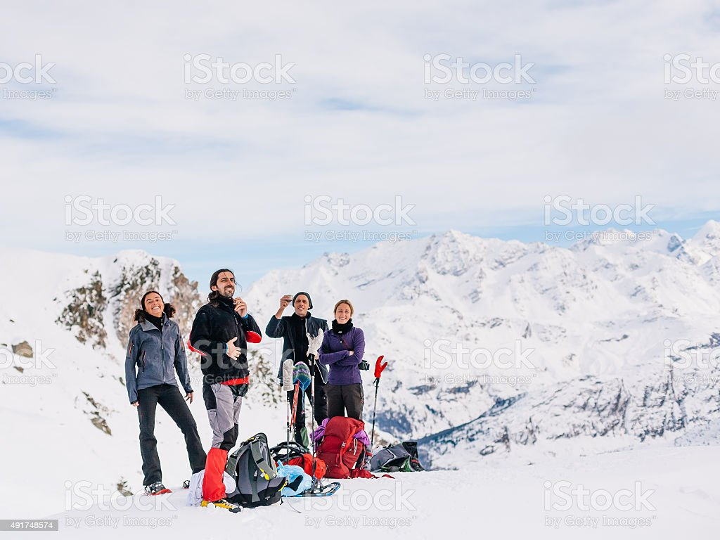 Climbers relax at top of mountain stock photo