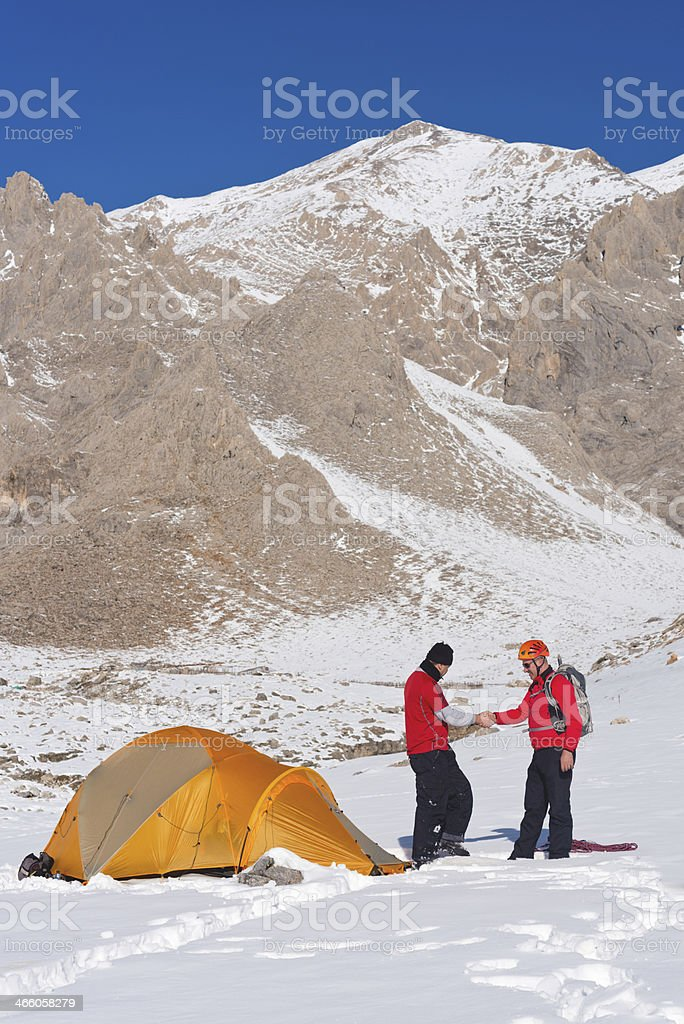 climbers resting at camp stock photo