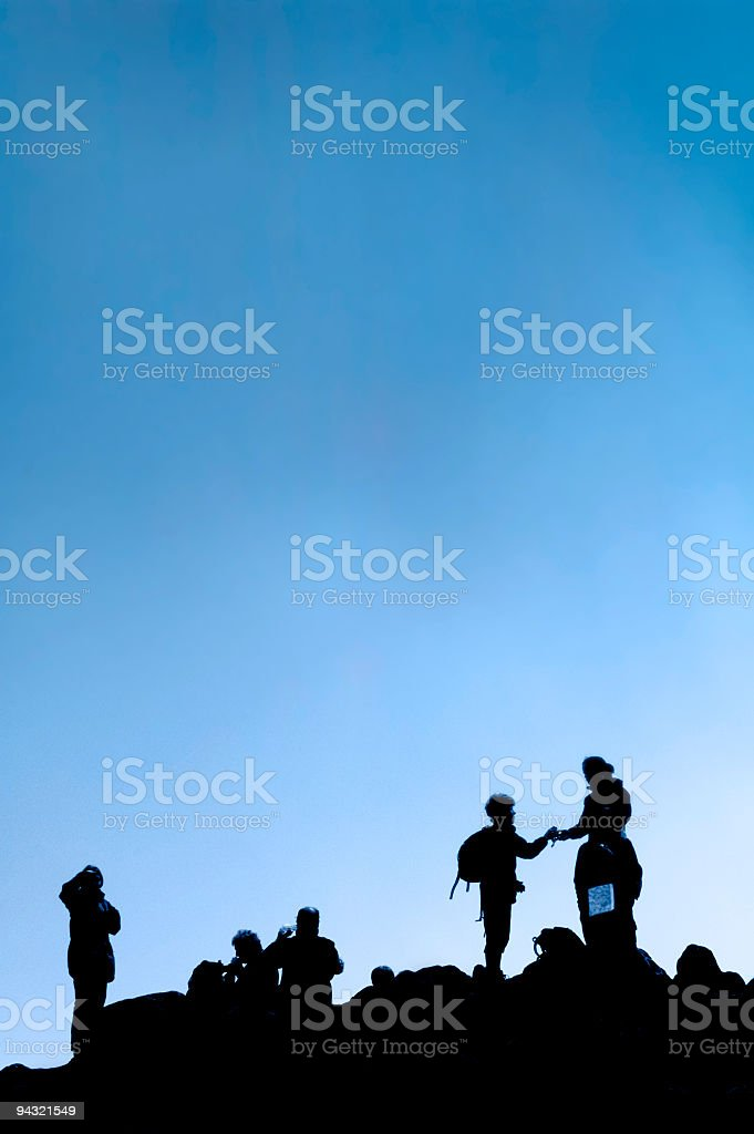 Climbers silhouetted royalty-free stock photo