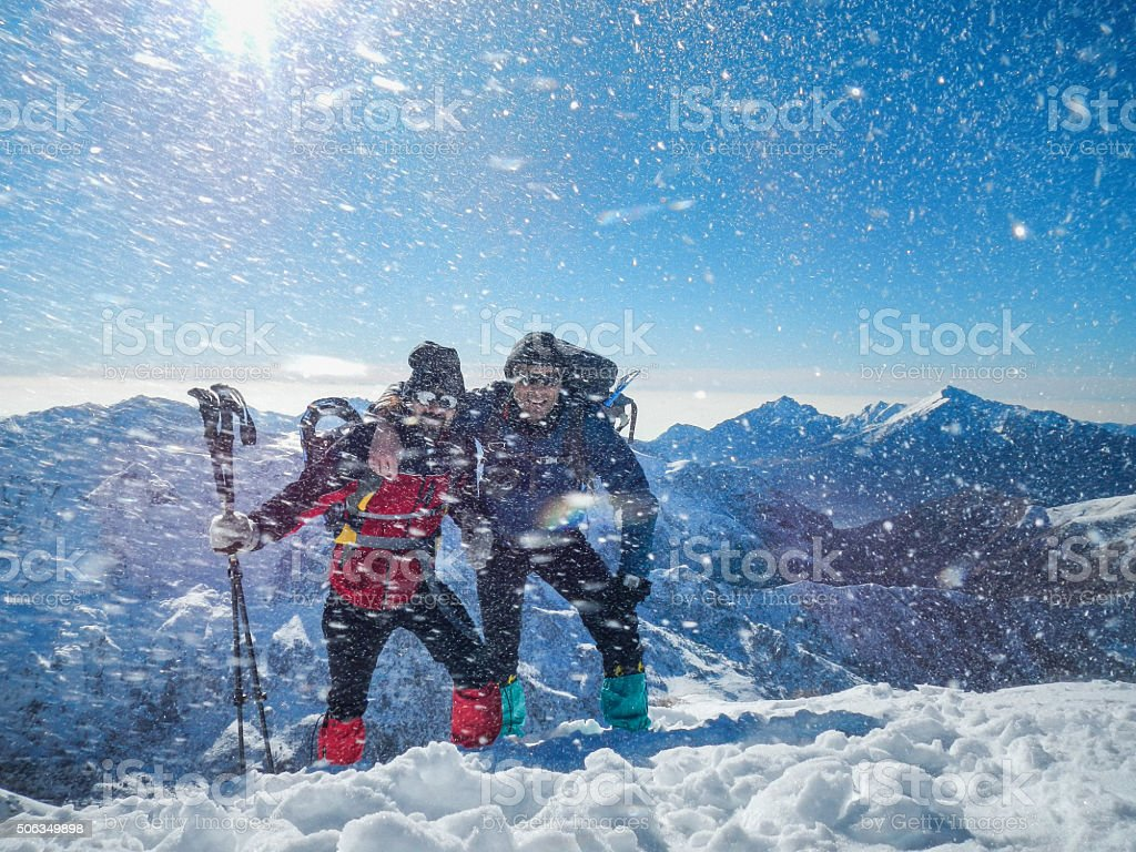 Climbers taking a selfie on top of the mountain stock photo