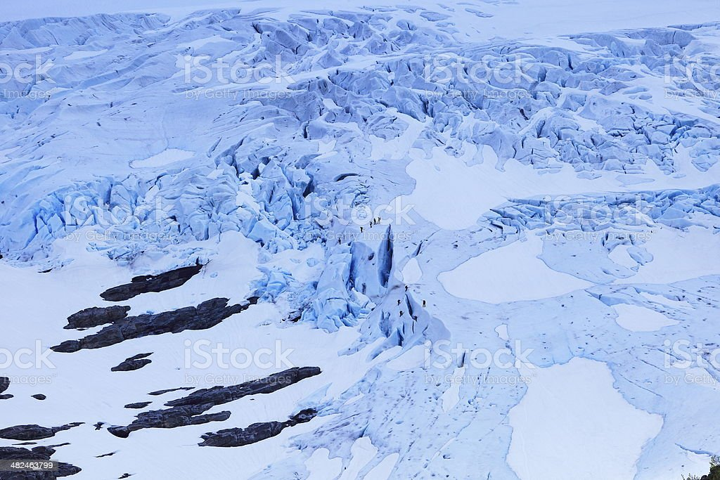 Climbers walking on the Bodasbreen snow glacier, Jostedal, Norway stock photo