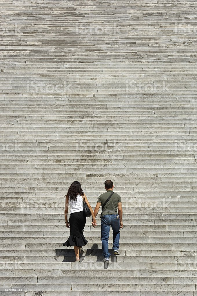 climbing a flight of steps royalty-free stock photo