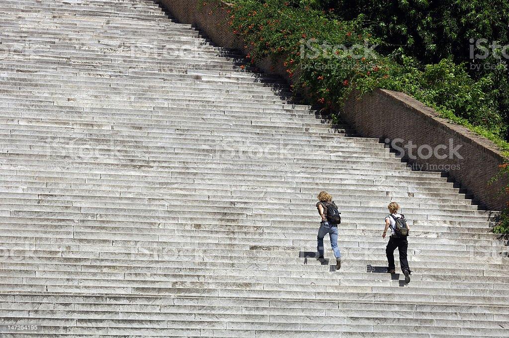 climbing a flight of steps royalty-free stock photo